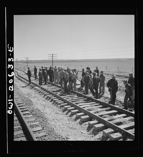 Clovis, New Mexico. Passing a section gang at work on the outskirts along the Atchison, Topeka, and Santa Fe Railroad between Clovis and Vaughn, New Mexico