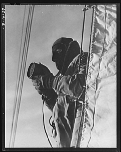 Coast Guard Auxiliary. Guardians of inland waters. As the need arises, member of the Coast Guard Auxiliary as temporary reservists, will take over duties of regular Coast Guardsmen, like this signalman using a blinker