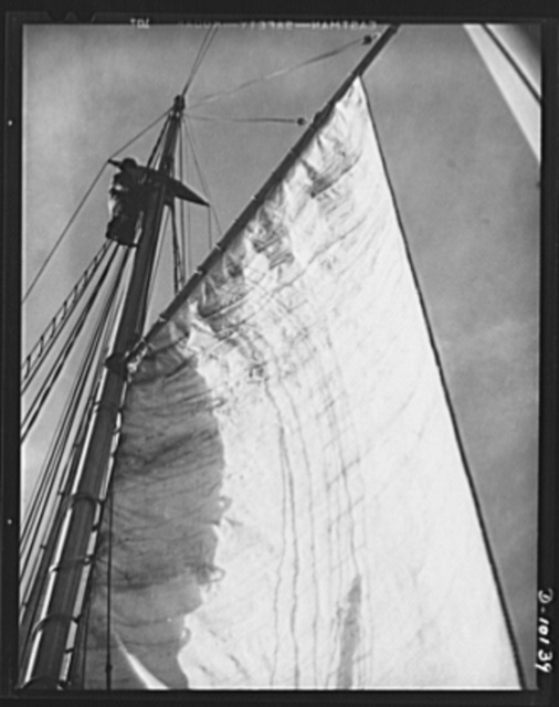 Coast Guard Auxiliary. Guardians of inland waters. Trimming sail. A Coast Guardsman climbs the mast of a schooner on patrol duty off Boston. Coast Guard auxiliarists are given instructions to carry on such work as the need arises