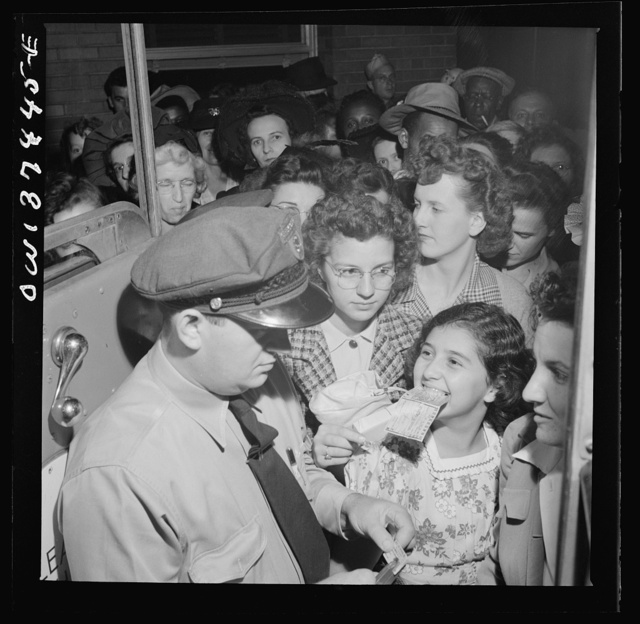 Columbus, Ohio. A Greyhound bus driver loading the bus