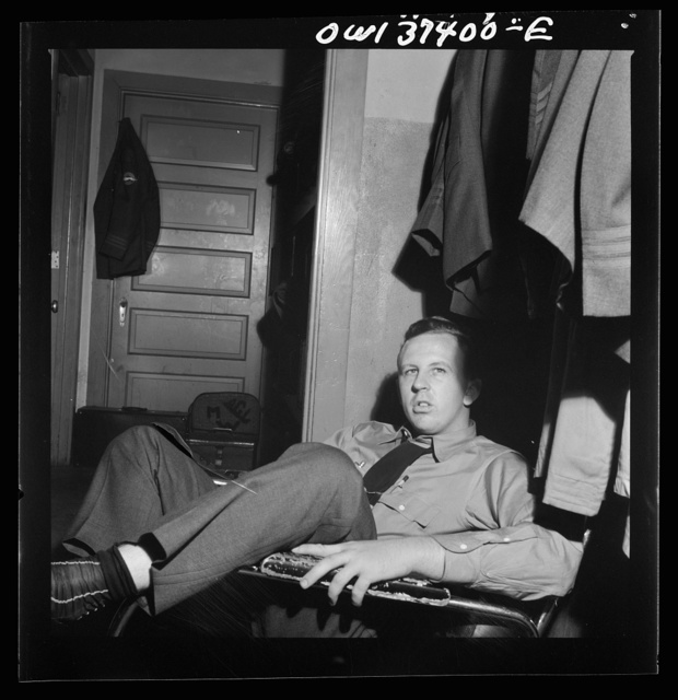 Columbus, Ohio. Clem Carson, a Greyhound bus driver, waiting for an assignment in the drivers' room