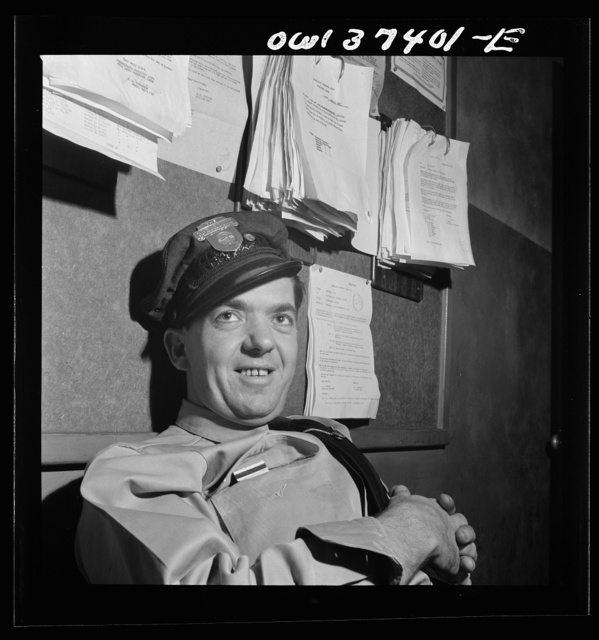 Columbus, Ohio. Clem Carson, a Greyhound bus driver waiting for an assignment in the drivers' room to go on duty