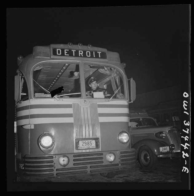 Columbus, Ohio. Lester Ward, a Greyhound bus driver, taking a bus out of the parking lot to go out on a run