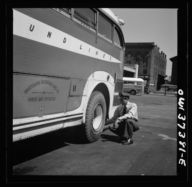 Columbus, Ohio. Randy Pribble, a bus driver for the Pennsylvania Greyhound Lines, Incorporated, checking tires on a bus by thumping them before taking it out on a run. Since there are two tires on the back, the sound is the best way of telling if one is flat