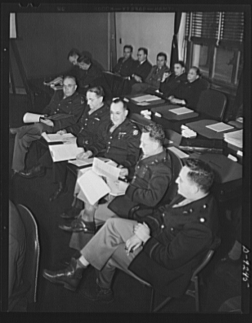 Combined Munitions Assignments Board. Staff members of the Combined Munitions Assignments Board attend the weekly meetings in Washington. In the foreground, left to right are: Colonel J.Y. York, Jr. (American); Colonel C.M. Steese (American); Colonel W.H. Hobson (American); Brigadier General P.H. Tansey (American); Lieutenant Colonel W. Skidmore (American). In the background, left to right are: Colonel V.V. Taylor (American); Major R.W. Jones (American); Captain D.S. Blossom, Jr. (American); R. Fisher (American); H.W. Knight (American); C.L. Terrel (American); Dr. I. Lubin (American)