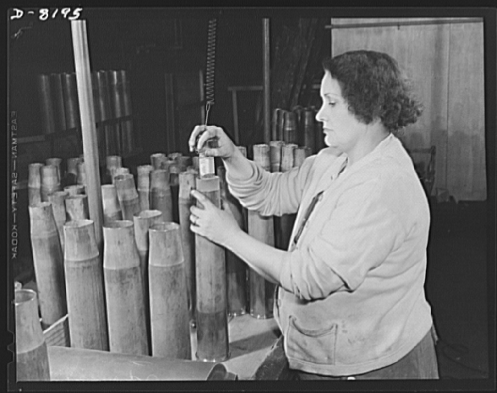 Conservation. Glass gauges replacing steel. Checking an inside diameter of a cartridge case with one of the glass gauges, which replace steel gauges at the Frankford Arsenal, are produced by acid etching. Glass gauges are lighter and cheaper than steel, permit greater visibility in inspection, are not as much affected by room temperatures and heat of operators' hands, are not corroded by perspiration, need no protection against rusting, do not acquire burrs that would change the effective sizes. They can save the annual use of 250 tons of critical tool steel in government arsenals alone