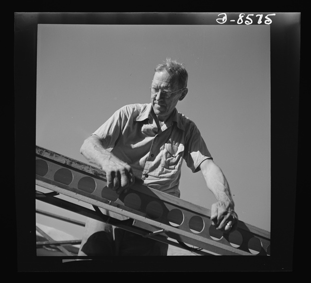 Conversion. Rowing shells to life rafts. At his old job making rowing shells for varsity crews, this veteran craftsman now helps produce plywood life rafts for Navy ships. Here he is shown at work on the frame of a rowing shell