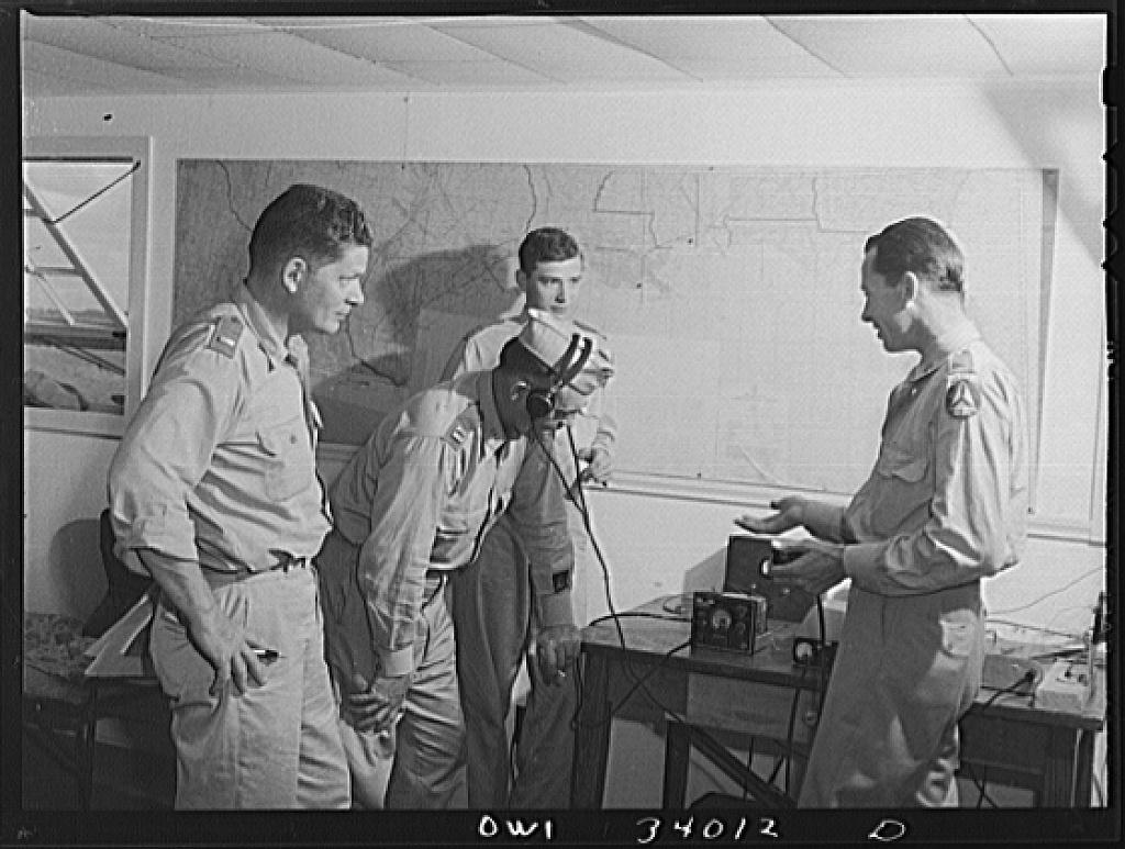 Corpus Christi, Texas. Lieutenant Ronnie Durham, a member of the Civil Air Patrol, instructing flight officers in radio telephone technique