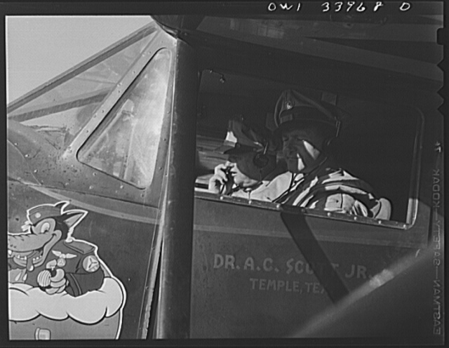 Corpus Christi, Texas. Lieutenant T.E. Hubby and Flight Officer A.R. Walker, members of the Civil Air Patrol, about to go on coastal patrol duty. Lieutenant Hubby was formerly an oil field clerk. Flight Officer Walker was a theatre manager in Broken Arrow, Oklahoma