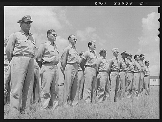 Corpus Christi, Texas. Officers of the Civil Air Patrol lined up in front of the planes for inspection