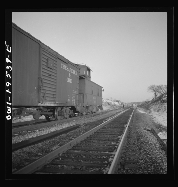 Dahinda, Illinois. A coupling pin jumps loose and the rear brakeman goes back to flag any oncoming trains on the Atchison, Topeka and Santa Fe Railroad between Chillicothe, Illinois and Fort Madison, Iowa