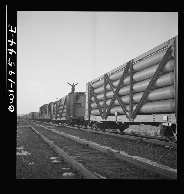 Dahinda, Illinois. On the Atchison, Topeka and Santa Fe Railroad between Chillicothe, Illinois to Fort Madison, Iowa, a coupling pin jumps loose and the train breaks in two. The conductor, riding on top of the train, signals the engineer as they back up in order to couple the cars together again