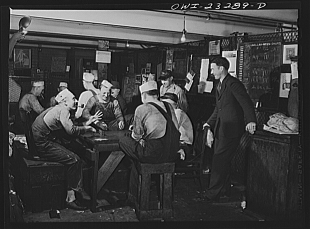 Dallas, Texas. Press operators on the Dallas Morning News playing dominos while waiting for the forms to come down from the composing room