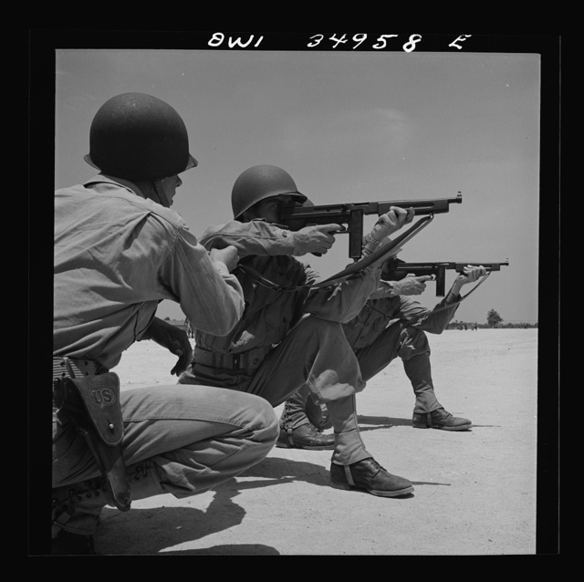Daniel Field, Georgia. Air Service Command. Learning how to use the Thompson submachine gun. Firing from a kneeling position