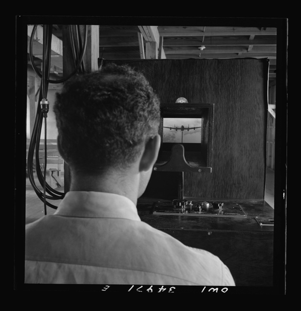 Daniel Field, Georgia. Air Service Command. Learning to identify aircraft in a machine which shows models in various positions, against various colored backgrounds, at varying intensities of light and for short or long periods of time