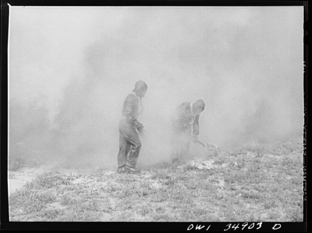 Daniel Field, Georgia. Air Service Command. Men of a chemical unit demonstrating the method of decontaminating a gassed area