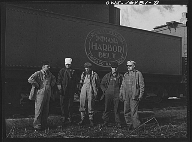 Daniel Senise and his crew with their engine in an Indiana Harbor Belt Line railroad yard. Left to right: E.H. Albrecht, switchman; Edward Kletecka, fireman; John McCarthy, switchman; Daniel Senise, switchman, conductor and foreman; and F.K. Gwinner, engineer