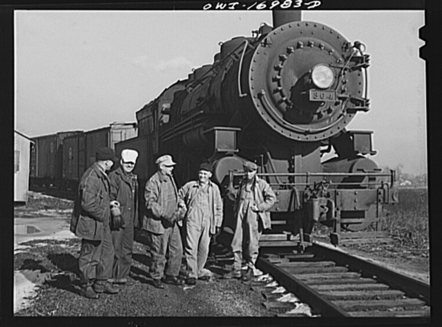 Daniel Senise and his crew with their engine in an Indiana Harbor Belt Line railroad yard. Left to right: Daniel Senise, switchman, conductor and foreman; Edward Kletecka, fireman; F.K. Gwinner, engineer; E.H. Albercht, switchman and John McCarthy, switchman