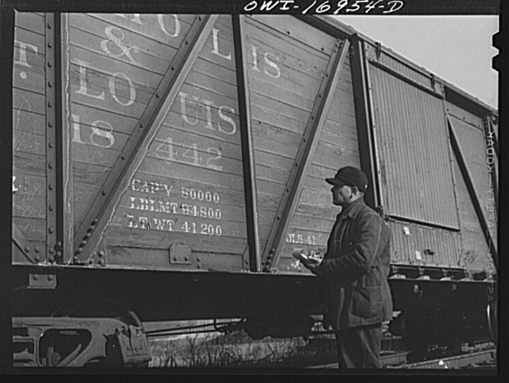 Daniel Senise checking cars at work in an Indiana Harbor Belt Line railroad yard. He is the foreman of his crew