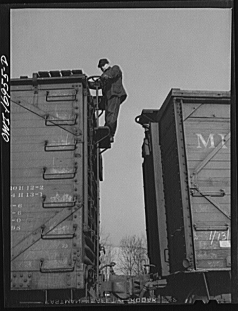 Daniel Senise releasing hand brakes on a car while at work in an Indiana Harbor Belt Line railroad yard