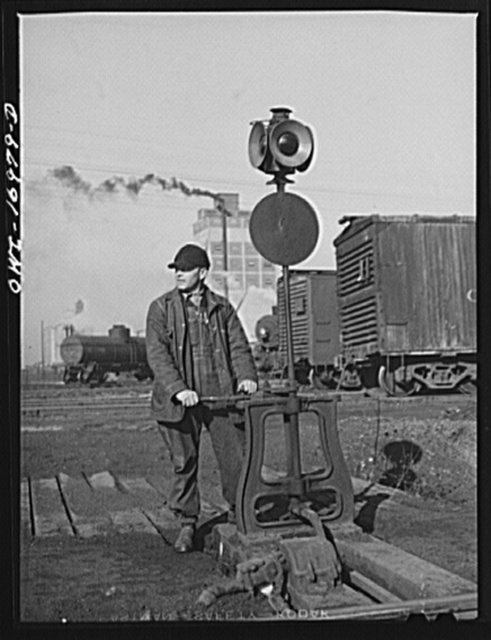 Daniel Senise throwing a switch at work in an Indiana Harbor Belt Line railroad yard