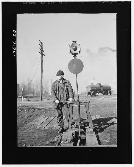 Daniel Senise throwing a switch while at work in an Indiana Harbor Belt line railroad yard