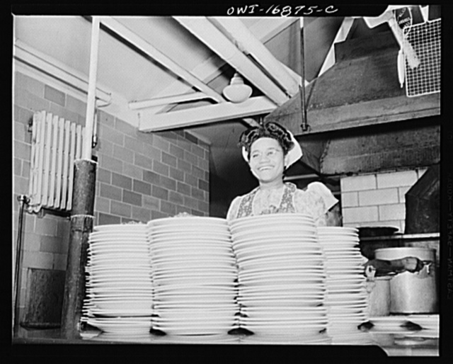 Daytona Beach, Florida. Bethune-Cookman College. Student preparing plate luncheons at lunch time. This work enables her to help with her tuition fees