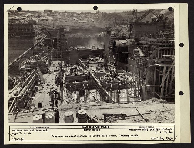 Denison Dam and reservoir. Progress on construction of draft tube forms, looking south