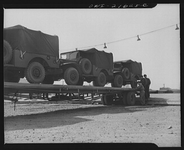 Detroit, Michigan. Army trucks on a haulaway