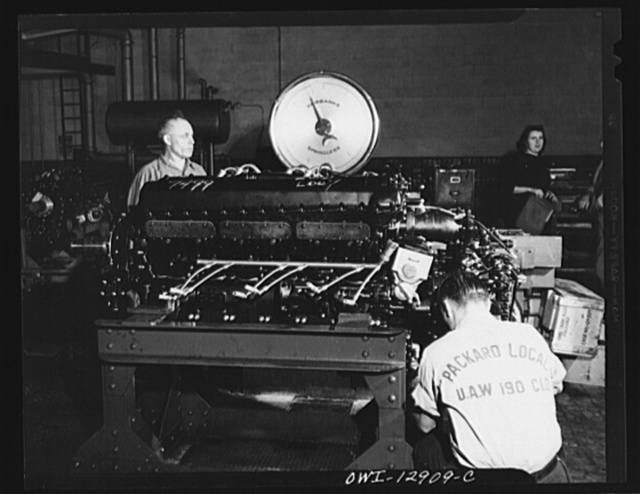 Detroit, Michigan. Assembly of Rolls Royce engines at the Packard motor car company.  Weighing engine to check total weight