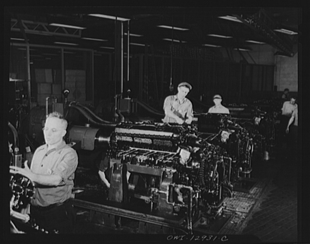 Detroit, Michigan. Assembly of Rolls Royce engines at the Packard motor car company. Flush-in stands