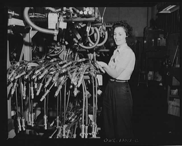 Detroit, Michigan. Assembly of Rolls Royce engines at the Packard Motor Car Company. Visual inspection of ignition wiring harness
