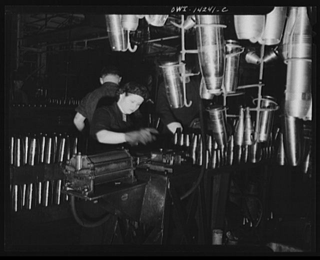 Detroit, Michigan. Steps in the manufacture of casings for 105 mm. shells in the Budd wheel plant. Stamping shell for identification