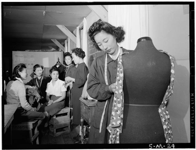 Dressmaking class, Manzanar Relocation Center, California / photograph by Ansel Adams.