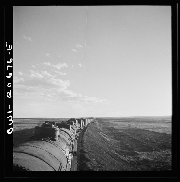 Duors, New Mexico. Going across sheep and cattle country along the Atchison, Topeka, and Santa Fe Railroad between Clovis and Vaughn, New Mexico