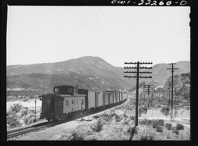 Eastbound Atchison, Topeka, and Santa Fe freight train near Cajon, California climbing the steep grade from San Bernardino to Summit