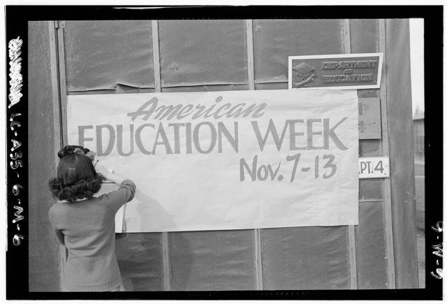 Education week sign / photograph by Ansel Adams.
