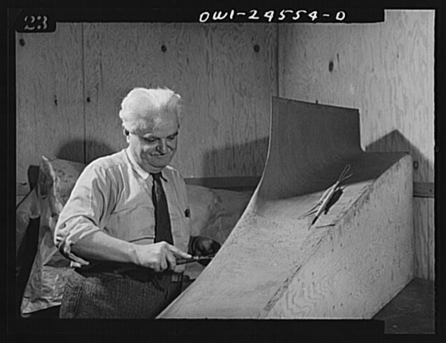 El Segundo, California. Italian-American at work on a model of a military plane at the Douglas Aircraft plant
