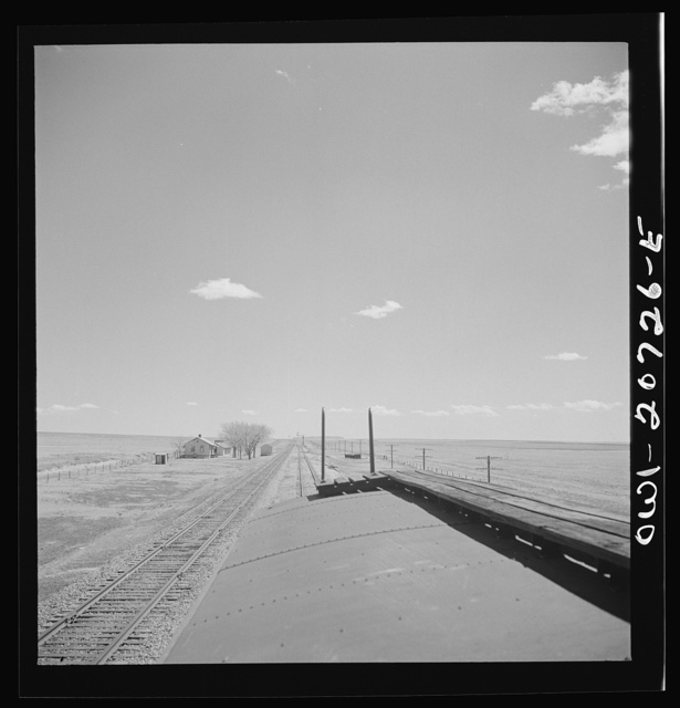 Encino, New Mexico. Passing a section house along the Atchison, Topeka and Santa Fe Railroad between Vaughn and Belen, New Mexico