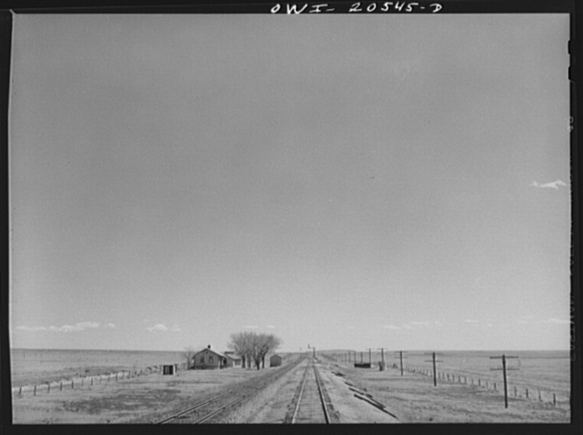 Encino (vicinity), New Mexico. Passing a section house along the Atchison, Topeka, and Santa Fe Railroad