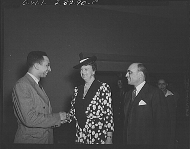 First lady inspects war workers homes. On an inspection tour of federal dormitories for war workers in Washington, D.C. on May 18, Mrs. Eleanor Roosevelt visited four projects recently erected for Negroes. Shown greeting the First Lady at George Washington Carver Hall, residential hotel for Negro men, is Hillyard Robinson, architect who designed the building. Looking on is W. Spurgeon Burke, resident manager of both Carver Hall and the Lucy Slowe Hall, residential hotel for Negro women war workers