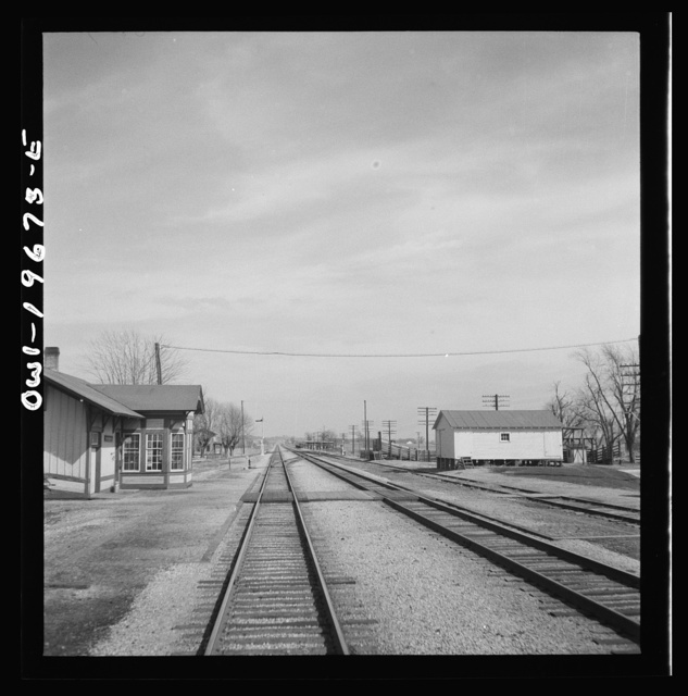 Floyd, Missouri. Going through the town on the Atchison, Topeka, and Santa Fe Railroad between Marceline, Missouri and Argentine, Kansas. The white building on the right is a potato barn