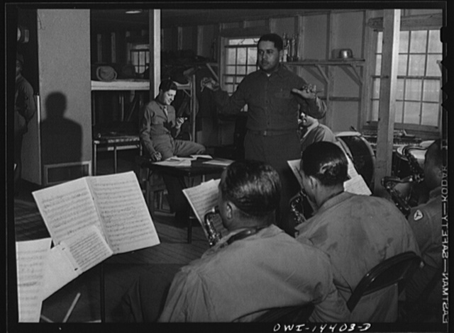 Fort Belvoir, Virginia. Sergeant Bianco (with watch in hand) at a rehearsal of a band for a radio show