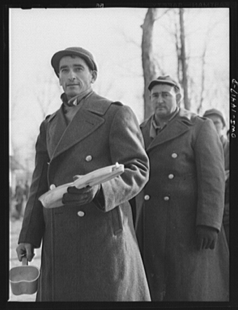 """Fort Belvoir, Virginia. Soldier of Italian descent waiting with his mess kit for noon """"chow"""""""