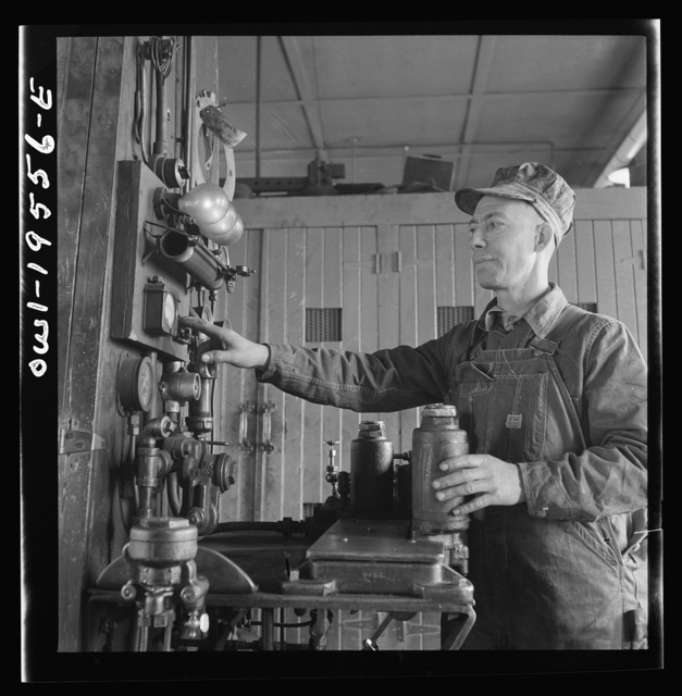Fort Madison, Iowa. In the train control room at the Shopton shops of the Atchison, Topeka and Santa Fe Railroad. Testing pnuematic train control equipment. This rack is used for testing about eight different parts of the apparatus