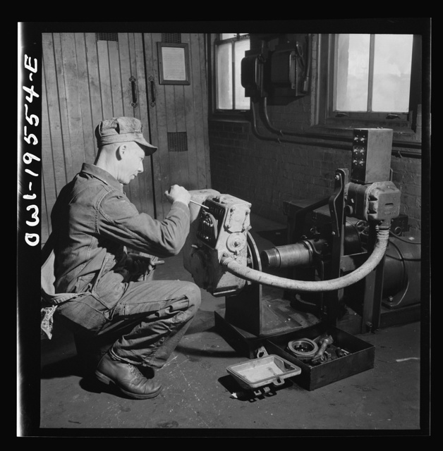 Fort Madison, Iowa. In the train control room at the Shopton shops of the Atchison, Topeka and Santa Fe Railroad. Testing the governor of a train control mechanism