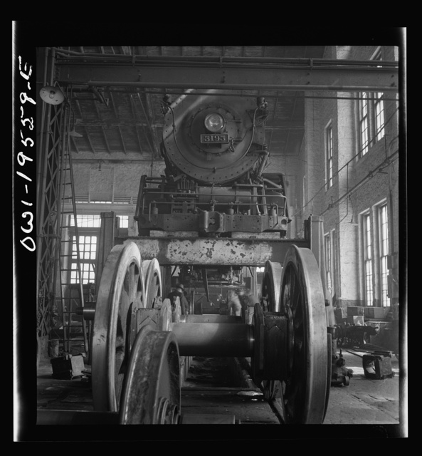 Fort Madison, Iowa. Wheeling and engine in the locomotive shops of the Atchison, Topeka, and Santa Fe Railroad