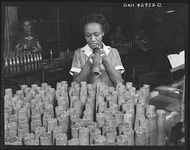 [Frankford Arsenal, Philadelphia, Pennsylvania.] Bertha Stallworth, age twenty-one, inspecting the end of a forty millimeter artillery cartridge case at the Frankfort [i.e. Frankford] Arsenal