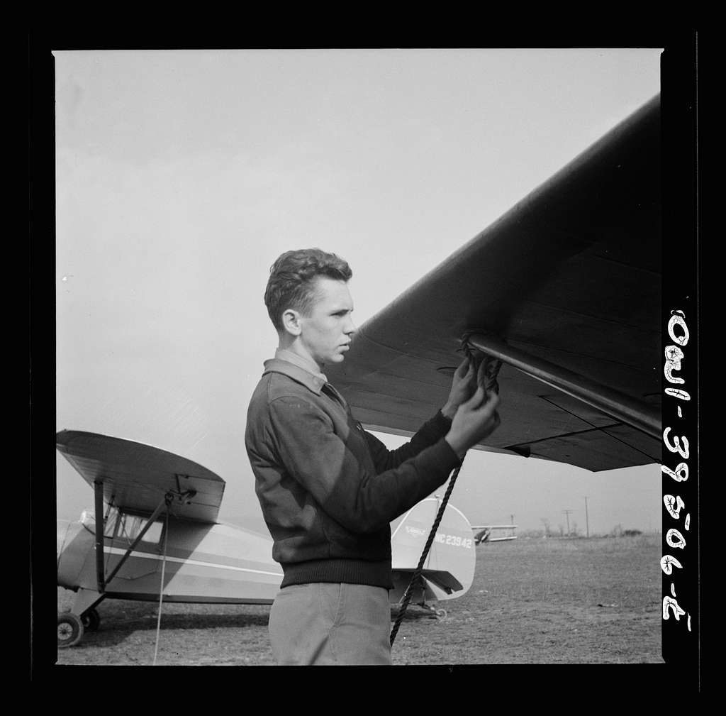 Frederick, Maryland. Returning from a practice flight at Stevens Airport, Walter Spangenberg, a student at Woodrow Wilson High School, ties down his plane