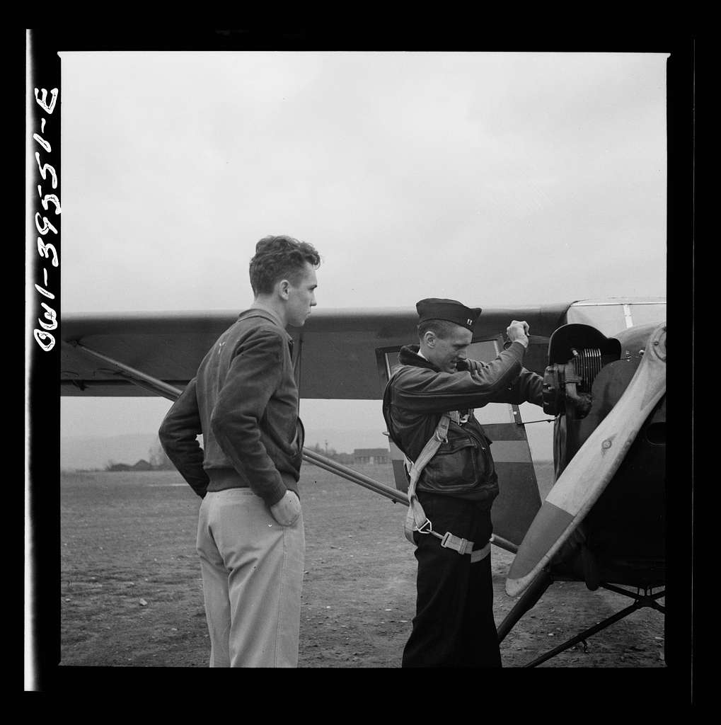 Frederick, Maryland. Walter Spangenberg, a student at Woodrow Wilson High School, watching another student get ready to take off at the Stevens Airport